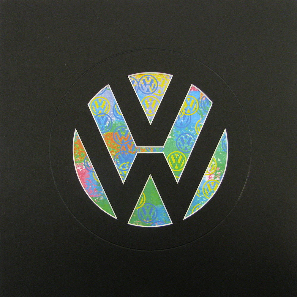 Black VW Logo with paper